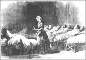 Engraving of Florence Nightingale with a lamp in a hospital ward.